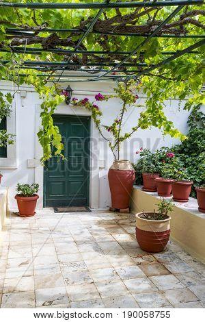 Green door in the Monastery of of Virgin Mary in Paleokastritsa, Corfu island in Greece.