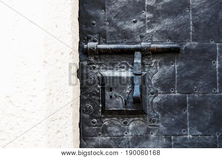Abstract vintage textured background with a combined latch and lock screws texture of rust and plaster . A horizontal frame.