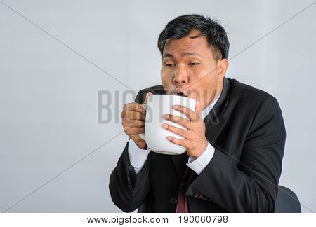 Hard working businessman Fatigue Drinking coffee /Isolate