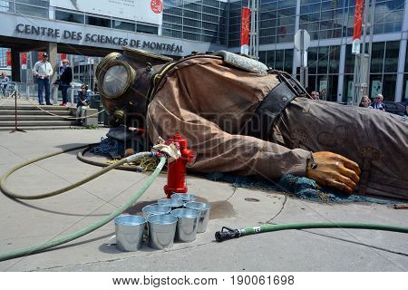 MONTREAL QUEBEC CANADA 19 05 17: The giant deep-sea diver sleeping in the street of Montreal for the 375e anniversary of the city, by Royal De Luxe company Nantes Franc
