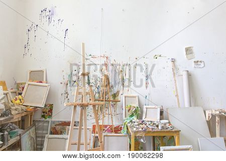 White wall stained with oil paint in the artist's studio interior workshop