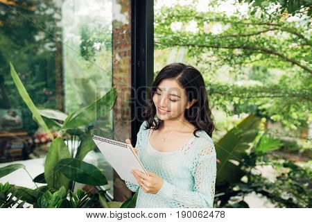Author, Typewriter, Journalist. Intelligent Woman Standing On Balcony And Thinking