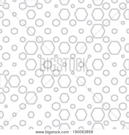 Abstract geometric background with gray hexagonal rings of different size.