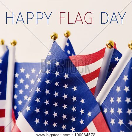 the text happy flag day and many flags of the United States against an off-white background