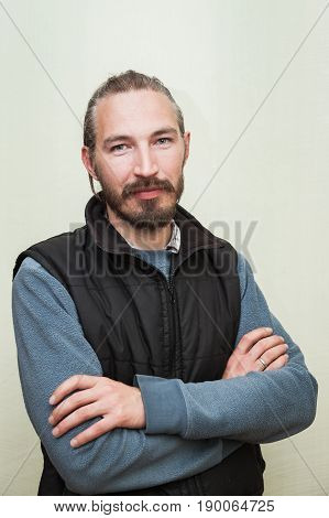 Bearded Asian Man Above Light Green Wall