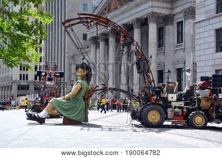 MONTREAL QUEBEC CANADA 19 05 17: The little giant girl sleeping in Place d'arme in old Montreal for the 375e anniversary of the city, by Royal De Luxe company Nantes France