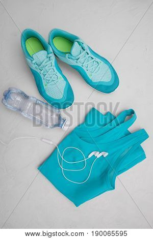 Sports Equipment - Running Shoes, A Smartphone