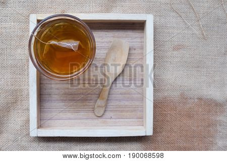 Hot tea in glass on wood tray tea time