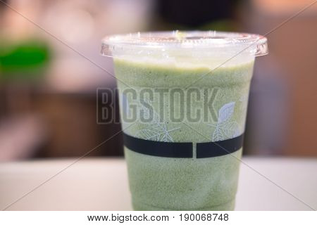 Green tea frappe and blended on table