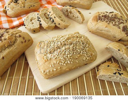 Homemade mini breads with sesame, linseed and black caraway