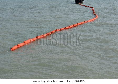 A containment boom is a temporary floating barrier used to contain an oil spill. Booms are used to reduce the possibility of polluting shorelines and other resources, and to help make recovery easier.