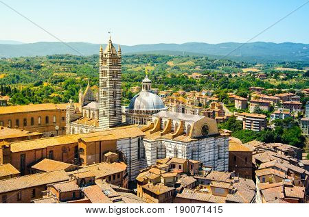 Metropolitan Cathedral of Saint Mary of the Assumption in Siena, aka Duomo di Siena, Tuscany region, Italy, Europe. Aerial view from Torre del Mangia.