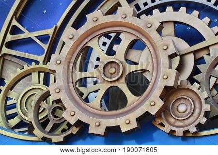 gold Cog and wheel details from clock machines of the industrial revolution