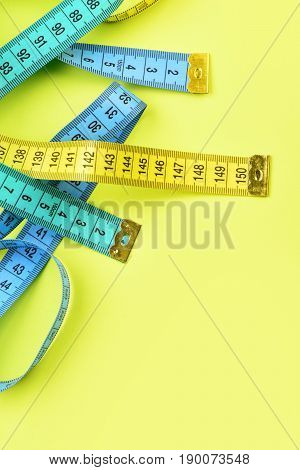 Measure Tapes In Lemon, Turquoise And Blue Colours