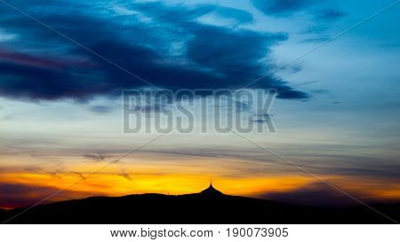 Colorful sunset sky panorama with silhouette of Jested Mountain Ridge, Liberec, Czech Republic.