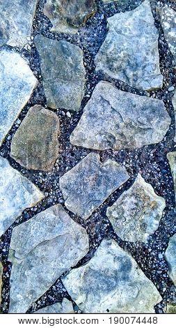 Pavement. Edited colors. Blue. Cold colors. Stones.