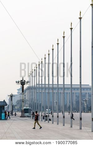 People Near Flagpoles On Tiananmen Square