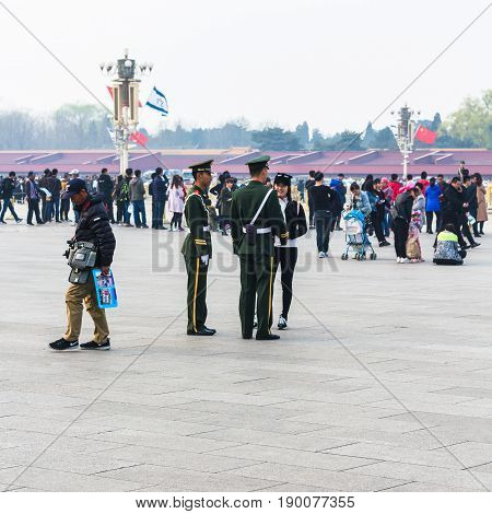 Tourists And Military Men On Tiananmen Square