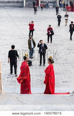 Couple And Photographer On Courtyard In Beijing