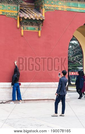 Tourists Take Photo Near Gate In Beijing City