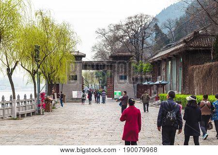 Tourists Near Gate To Longmen Grottoes