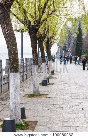 Tourists On Embankment Of Yi River In Longmen