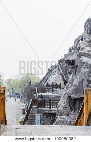 Tourists And Carved Slope In Longmen Grottoes