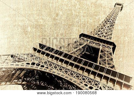 France. Paris. View of openwork Eiffel tower in style old shabby photos. Photo on canvas with lighted edges.