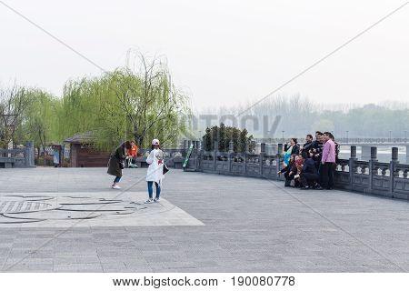 Tourists Take Photo In Longmen Grottoes Area