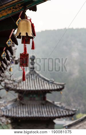 Bell And Pagoda On East Hill In Longmen Grottoes