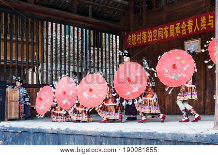 Dancers With Umbrellas In Dong Culture Show