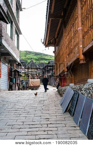 Old Woman On Alley In Chengyang Village