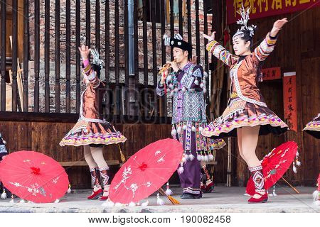 Folk Actors With Umbrellas In Dong Culture Show