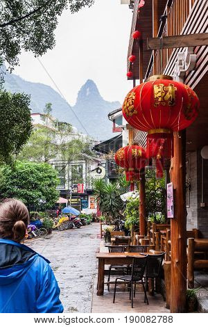 Tourists And Cafe On Alley In Yangshuo Town