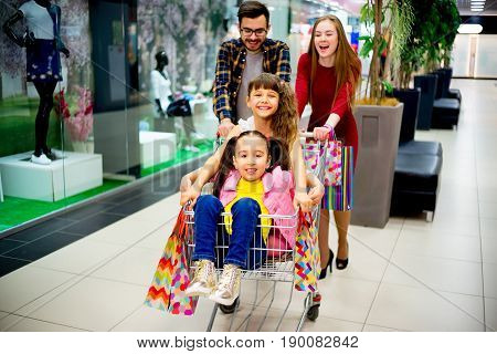 A happy family is shopping together in a mall