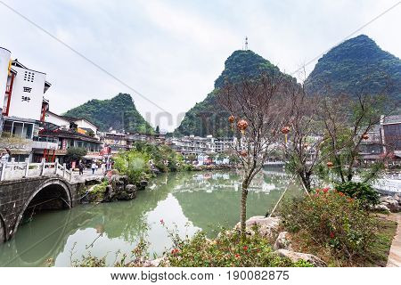 Tree With Lanterns And Bridge In Yangshuo Town