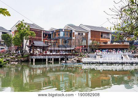 People On Waterfront In Yangshuo Town In Spring