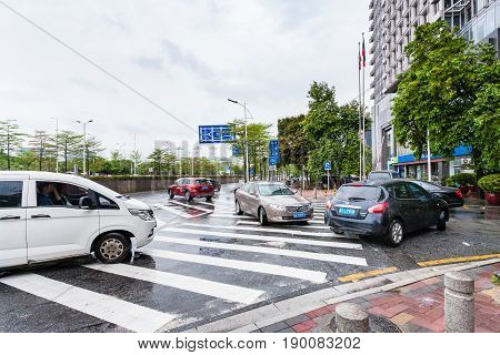 Wet Street With Cars In Guangzhou City In Rain