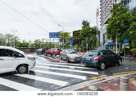 Parked Cars On Wet Street In Guangzhou City
