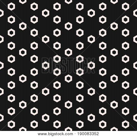 Hexagon texture vector pattern. Monochrome seamless pattern. Small perforated hex shapes in hexagonal grid. Abstract dark geometric background. Symmetric design element for prints, digital, web, fabric.