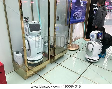 People Play With Promotion Robots In Hall
