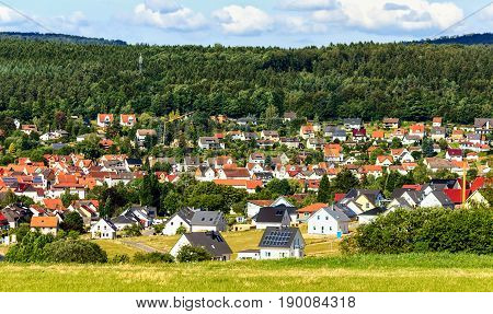 Picturesque green summer landscape with houses near Kassel, Germany