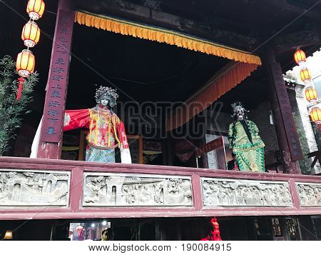 Puppets On Facade Of Opera Stage In Xingping