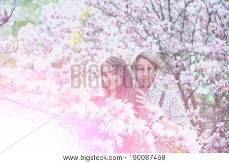 Couple In Love, Man And Girl Enjoying Magnolia Flower Blossom