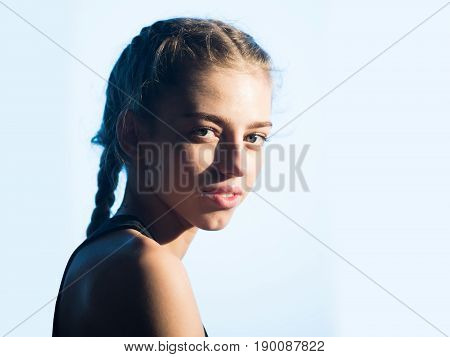 Adorable Girl With Green Eyes And Plaits
