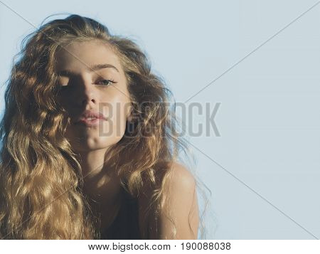 Cute Girlwith Young Face And Natural Blond, Long, Wavy Hair
