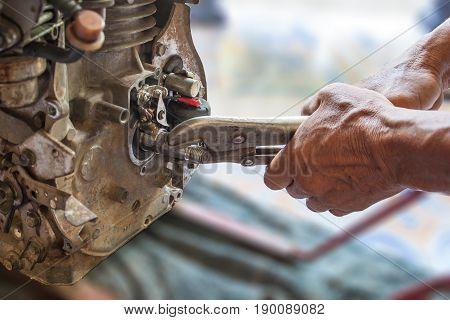 Repair pump machine on hands selective focus.