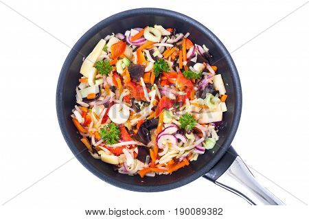 Fried mixed vegetables with mushroom mun, bamboo shoots and soybeans. Chinese cuisine. Studio Photo