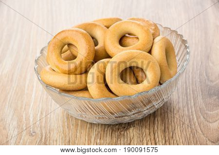 Small Bread Rings In Transparent Glass Bowl On Table