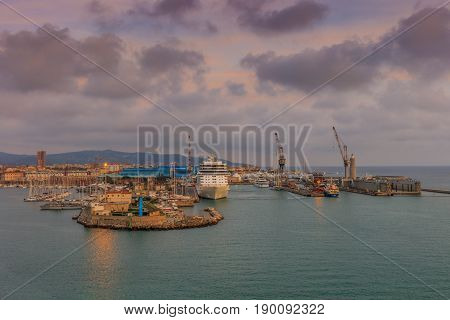 loading cranes on dockside in port of Livorno Italy